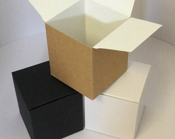 Candle  boxes Height 102mm x depth 87mm x width 87mm in White, Black or Kraft. With free matching gift tags.