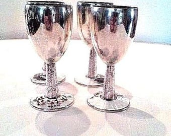Sterling silver goblets with white enamel base and floral design