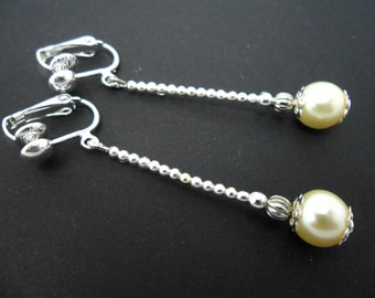 A pair of ivory colour glass pearl  bead clip on dangly earrings.