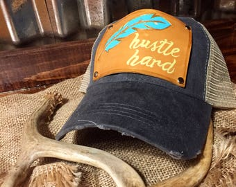 Hustle hard leather patch trucker hat