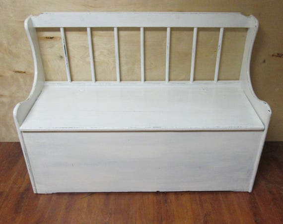 Bench with storage compartment