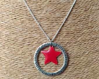 Necklace made with a silver chain and a pendant circle and Star