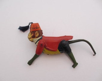 vintage MAR Line Toys metal Jocko monkey tin toy collectible made in japan occupied japan toy red jacket fez with tassel climbing toy