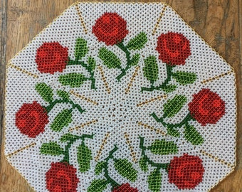 Beaded doily with red roses