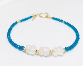 Blue Apatite genuine glittering gemstones with Moonstones and 14k gold spacers with 14k gold toggle.