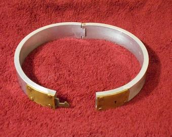 Locking aluminum and brass slave collar