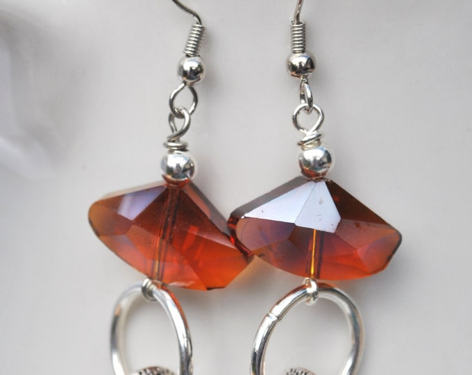 Burnt orange Crystal Earrings with shiny silver hoops and saucers