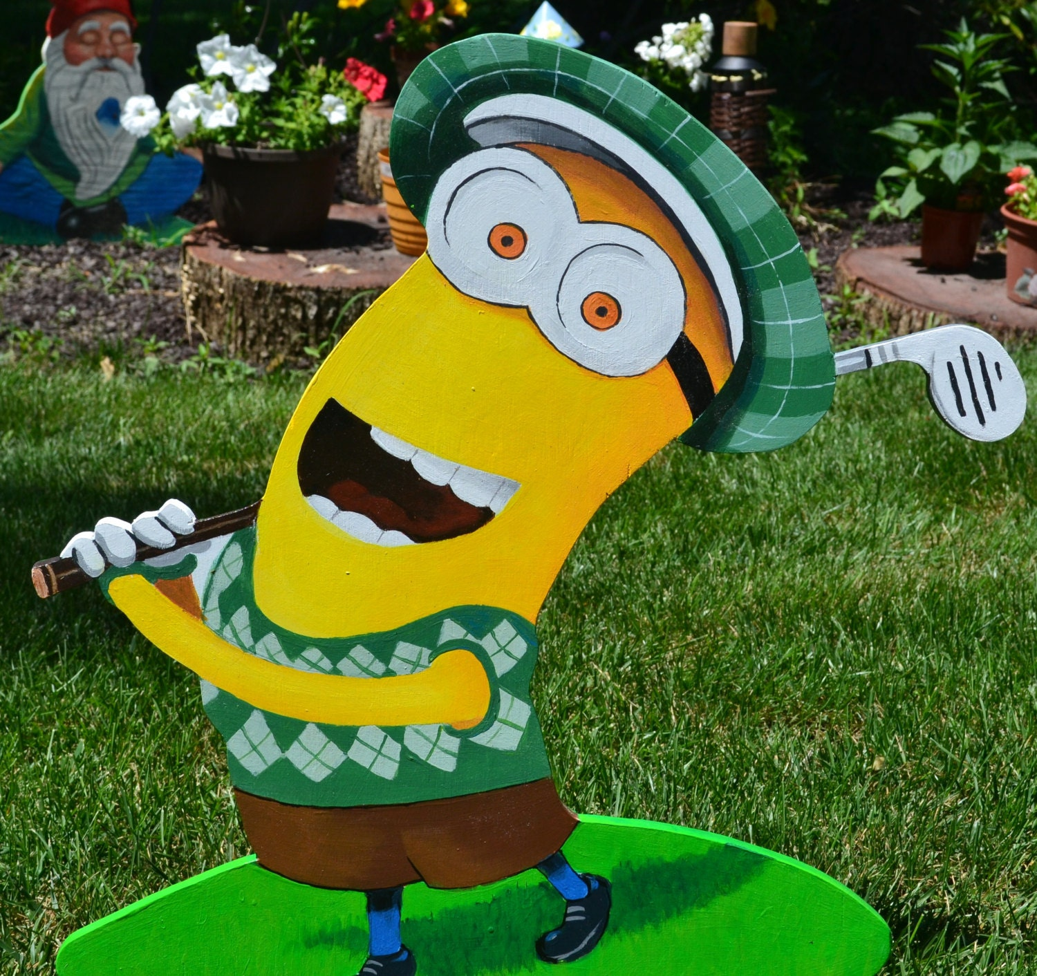 Kevin Minion teeing off in golf lawn art stake or wall plaque