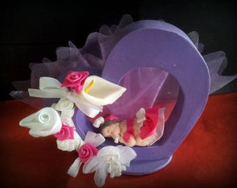 wooden heart decorated with baby