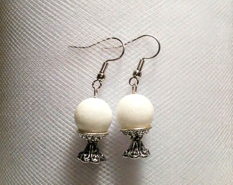 White marble stone crystal ball on a silver plated bead cap stand earrings