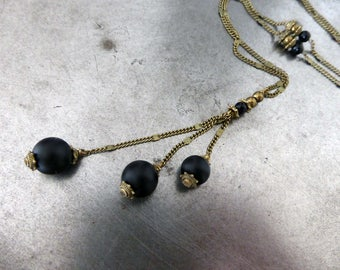 Long carefree black matte, glass beads.