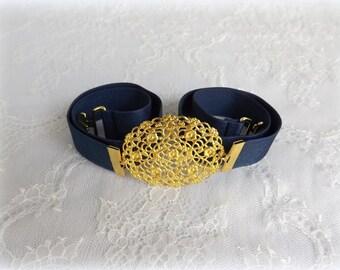 ON SALE. Navy blue elastic waist belt. Gold oval centerpiece. Dark blue Strechy dress belt.