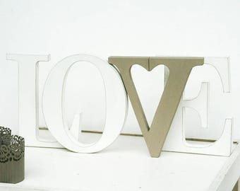 "LOVE written in SHABBY style wood with a heart shaped letter ""V"""