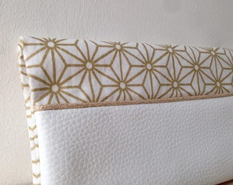White faux leather checkbook and gold geometric fabric.
