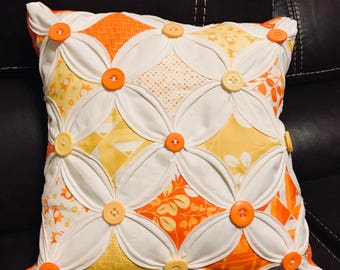 Fall themes cathedral window pillows.