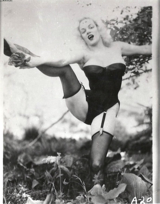 vintage snaphot high kick corseted busty blonde bombshell