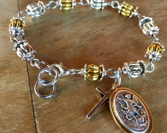 Prayer bracelet, handmade with tibetan silver and gold beads, ornate tibetan silver bead caps, crucifix and St. Michael charm