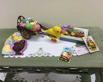 Miniature Easter cart with pastel eggs