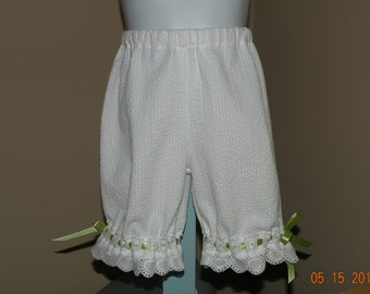 White Capris with eyelet and ribbon trim
