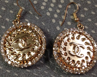 Designer buttons repurposed into earrings