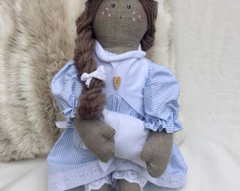 Sofia, cloth doll-baby girl going to sleep with her pillow-soft doll