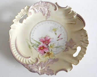 Large vintage decorative platter with floral designs and gold highlights