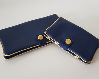 All checkbook and cards in Navy faux leather and Gold piping