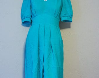 Turquoise vintage pleated dress with pockets