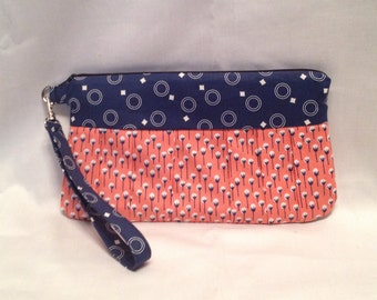AK5- Compleat Clutch: in a smart cotton ball print with pleated front, zipper closure and detatchable hand strap