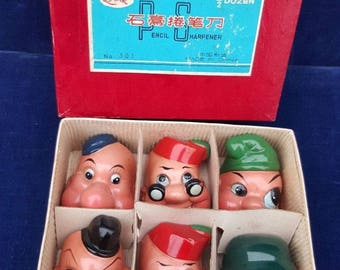 Box of 6 vintage Lark gnome head pencil sharpeners
