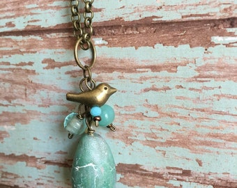 One Of A Kind ~ Hand Made Faux Stone Bird Egg in Jade with Brass Bird and Beach Glass Beads.