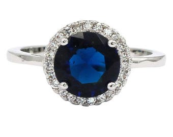 A layer micro-inlaid surrounded blue crystal silver ring