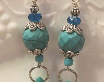 Turquoise dangle earrings with pewter bead caps