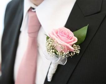 rose boutonniere,bridal accessories,bride flowers