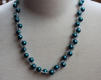 Necklace woven with Teal glass beads
