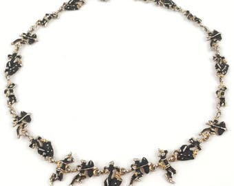 Vintage Ethnic Tribal Figure Necklace with Drummers, Dancers, and Warriors - Silver People Charms with Black Enamel and Gold Accents