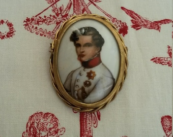 Antique brooch in the effigy of Napoleon II, son of Napoleon Bonaparte in Limoges style porcelain cameo.