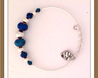 Bracelet Handmade MWL deep blue faceted beads with silver ball spacer beads. 0229