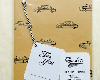 Retro hand stamped wrapping paper and gift tag. Vintage 1950's automobile stamp. Black ink on brown paper.