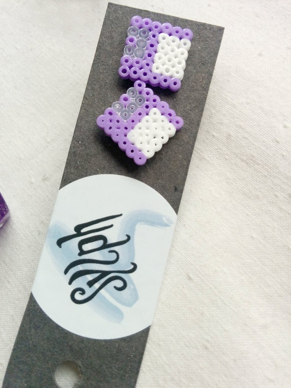 Light purple Geek IT floppy disk shaped stud earrings for computer geeks and gamer girls with retro style made out of Hama Mini Perler beads