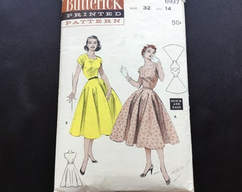 """Butterick pattern 6937. Vintage uncut 1954 misses' """"quick and easy"""" dress with cut out neckline. Neckline variations cropped sleeves."""