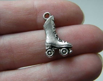 8 Roller skate charms antique silver tone SP48