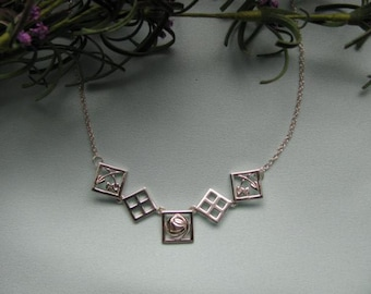 "Elegant Sterling Silver Necklace inspired by the designs of 'Charles Rennie Mackintosh!'  Necklace adjusts from 17"" to 18."""