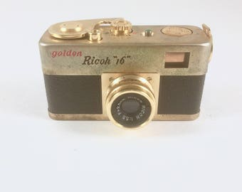 Spy Camera, Golden Ricoh 16 Camera, Leather Case. Subminiature,  1950s, Early 1960s Miniature Camera, Golden Ricoh Steky 16, Hard Shell Case