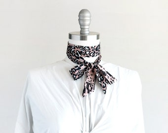 Blush and black skinny scarf in a striking leopard and graphic pattern-play, choker, bow, hair tie, small luxuries