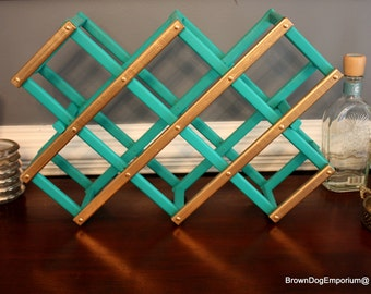 wine rack hand painted aqua blue and gold leaf // painted wooden accordion wine rack // bar decor