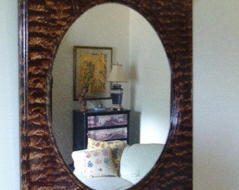 Oval mirror vinegar painted in walnut.