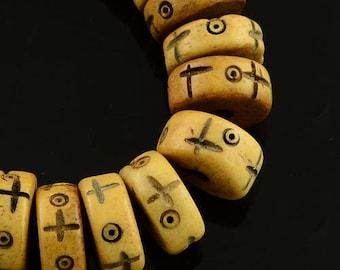 Pearl yak bone beads, antique, round, flat, heishi lightkhaki 10 x 4 mm sold per 10