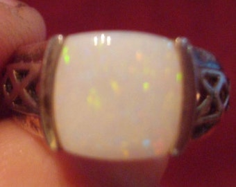 Opal Ring with filigree design on the side