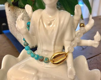 Golden strands bracelet, blue Jasper and white jade.